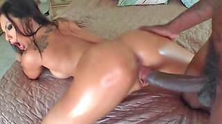 Desirable Asian hottie rides on a large black piston