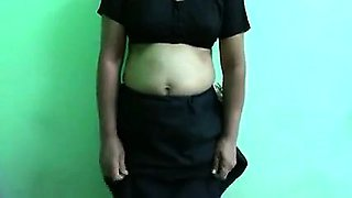 This is a hot video of a Bangla housewife who is stripping