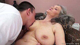 Sex-starved granny with big natural tits gives hot blowjob to her lover