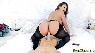 Hot Babe With Her Lingerie Riding Her Big Dick Toy