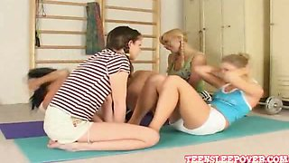 Lesbians kissing and getting naked at the gym
