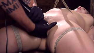 Dominant man fingers and masturbates girl's pussy in BDSM video