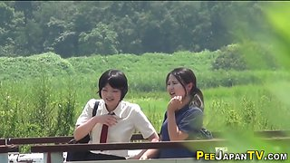 Asian teens piss in ditch