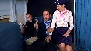 Slutty stewardess fucks a first class flyer as people watch