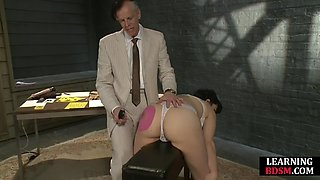 BDSM dom spanks brand onto his subject