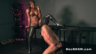 Busty black mistress has interracial sex with sub