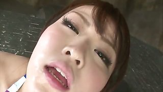 Squirting idol Tomoka Sakurai in a colorful bikini toys her