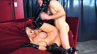 Latex mistress bangs her well-hung slave hard
