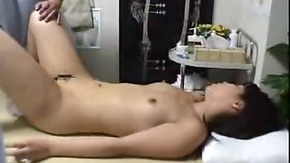 Nudist Japanese milf fingered to extasy on massage bed