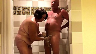 Curvy mature wife reveals her handjob skills in the shower