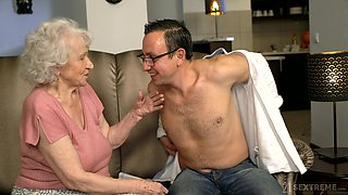 Senile granny with big boobs Norma B gets intimate with young man