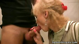Innocent blonde struggles hard for loads of cum