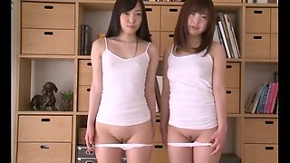 Two japanese schoolgirls show their plump pussies