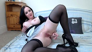 Stacked brunette maid in lingerie flaunts her amazing curves