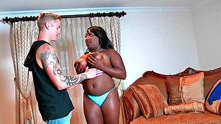 Curvy black slut rides a horny white boy passionately