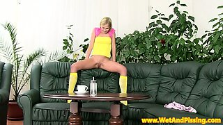 Watersports blonde pees into clit pump