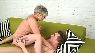 Granny gets facialized after pussy plowing by youngster