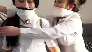 Chinese secretaries in white shirts are thoroughly gagged