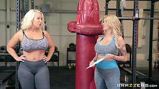 busty lesbos fuck in the gym