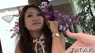 Asian bitch blows a ramrod and gets anally pleased after