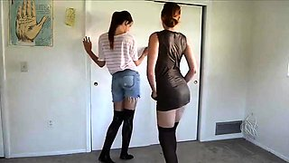 Two sexy young lesbians in stockings strip off their clothes