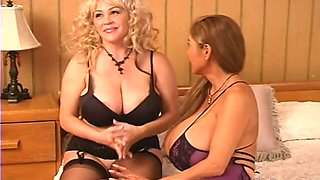 Two hot busty babes have fun in the room. Tasty video