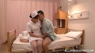 Asian nurse taped fooling around with a patient