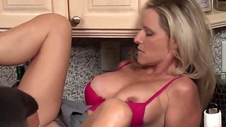 Stepson with monster cock fucks his mature stepmom in the kitchen