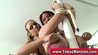 Lesbo domina twists nipples and gags hoe in fetish action