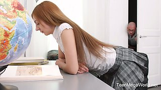 Sexy red haired college babe Veronika Fare is fucked by one bald headed fellow