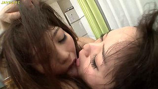 These Japanese lesbians have no problem kissing each other in front of me
